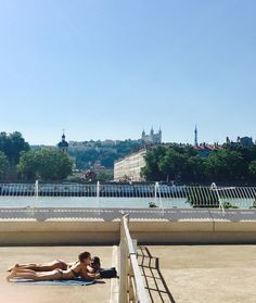 Some tan with a view centre nautique Tony Bertrand in Lyon - The perfect plan for a sunny day: 3 ultimate activities to do in Lyon when it's hot @C'est la vie guide