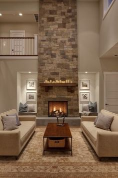 by Shuffle Interiors    This fireplace was handcrafted and dry-stacked by an artisan mason who shaped and placed each stone by hand. Our designer hand-picked stones from each palate to coordinate with the interior finishes. Remaining stones were also hand-selected...