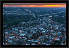 Downtown Boise at sunset, with the newly completed 8th & Main building, viewing west. Aerial photograph, 7/14