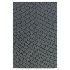 This handmade wool rug pairs a slate gray palette with a mosaic-inspired motif.  Product: RugConstruction Material: W...