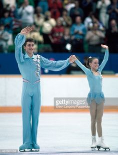 Pairs figure skaters Sergei Grinkov and Ekaterina Gordeeva of the USSR waving to the crowd after completing their performance at the Winter Olympic Games in Calgary, circa February 1988. They won the gold medal.