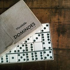 Vintage black and white Marblelike dominoes, complete set of 28. These date somewhere between the late 1940s to the 1950s.  Each domino measures about