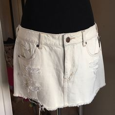 NWT distressed denim skirt A spring/summer wardrobe staple! Distressed denim skirt - has the light almost yellow tint Jean color American Eagle Outfitters Skirts Mini
