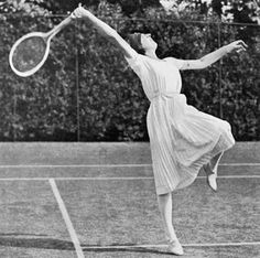 1920 Suzanne lenglen sought to rationalise clothing on court during her reign over the Wimbledon's women's final. Discarding both corset and petticoat' she replaced the established blouse, tie and a long skirt, her signature outfit. Designed by Jean Patou. She wore a bandeau around her head, thus sportswear was a significant factor in dress reform.