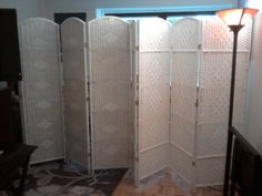 Another example of how a living room transforms into two rooms by using attractive and cost effective room divider folding screens. Here you can see 2 four panels diamond weave screens in white. Thank you Jackie from New York, NY Tudor City.