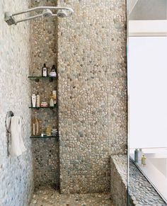 Pebble and river rocks tiles-nice use of space with the recessed niche shelving