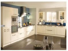 shows grey does work on worktops and floor. plus like the blue wall