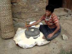 Grinding flour by hand in Bhutan