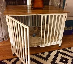 Repurposed crib to dog crate with barn board table top. More