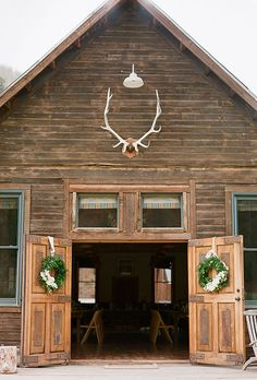 Antlers and lush wreaths are great winter wedding decorations | Brides.com