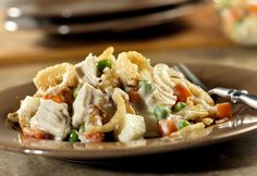 Need to feed a crowd? This creamy version of a chicken and potato salad is actually a casserole that is served hot from the oven...it's a real crowd-pleaser.