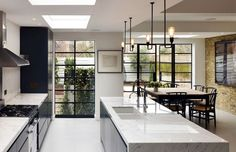 On The Square With Stiff + Trevillion Light floods this stunning kitchen through the industrial Crittall windows. Project by Stiff + Trevillion. Photograph by Kilian O'Sullivan. Home Decor Kitchen, Kitchen Furniture, Kitchen Interior, Home Kitchens, Kitchen Doors Uk, Small Kitchens, Kitchen Ideas, Kitchen Diner Extension, Open Plan Kitchen