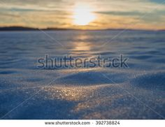 Stock Photo: Blurred sunset at a frozen lake in the winter evening in Finland. Very shallow depth of field used to create the ethereal mood in the picture.