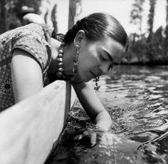 Frida drowning her sorrows