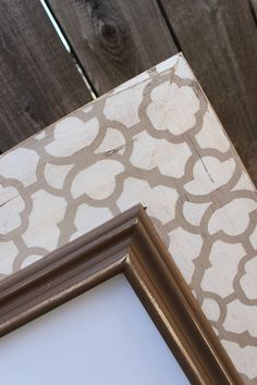 Patterned board or canvas behind a smaller piece of artwork