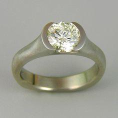 Engagement Ring 5-6: Round cut diamond partial bezel set in platinum