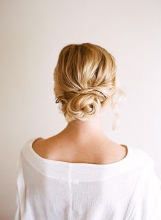 This romantic look from Anne of The City Sage works on any hair type—but if you've got naturally straight, fine hair, put in a few curls first for a little help with texture. Separate hair into three or five sections, and put the middle (back) section in a ponytail and then in a bun. Twist the sections on each side over the bun to create a multidimensional look. Use a spin pin to secure, and leave a few pieces loose around the face.