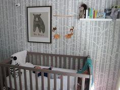 Birch tree stenciled wall in a boy's woodland nursery