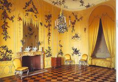 Sancoucci - Voltaire room (he supposedly lived here while in residence at the palace from 1750 till 1753), the room features wood paneling painted a beautiful yellow, marble floors and a built in bed