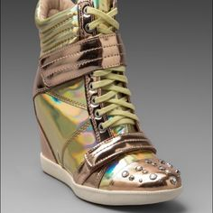 Boutique 9 hologram wedge sneakers Dope as hell! I've litterally worn these bad boys ONE time! I am in love with them but they're just a bit to snug! Size 6, box says 5 (just now noticed this) excellent condition! Originally $198 + tax - Sold out! Boutique 9 Shoes Sneakers
