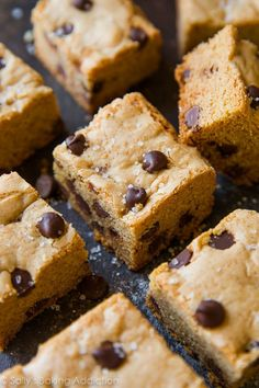 Super soft and extra chewy chocolate chip cookies as bars! No dough chilling, no mixer, and no rolling into balls! Recipe on sallysbakingaddiction.com
