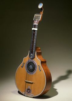 """1780 Portuguese English guitar at the Victoria and Albert Museum, London - From the curators' comments: """"The English guitar was a fashionable instrument from about 1750, considered easy to play and tuned in C major, although the player would use a capo, much like a modern folk-guitarist, in order to change the key. The tuning pegs were often small metallic pins that could be turned with a watch-key, to keep the strings in tune longer."""""""