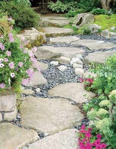 Keeping Feet Dry    At first glance, this area looks like a dry creek bed somewhere in the Cascades. Actually, it's a cleverly designed footpath that leads from a driveway to a house. The path is composed of flat stone slabs edged by rocks that shore up planting beds.