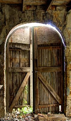 Beautiful old arched doors. So weathered, and well worn. Well tended to!