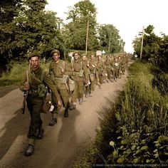 The 1st Battalion Welsh Guards move forward, Normandy, July 1944. This image is one of a series colourised by Tom Marshall at PhotograFix – Restored and Colourised Photos, for a new book by Trevor Royle on the history of the Welsh Guards 1915-2015.