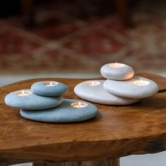 Unique candle holder brings soothing light to your place with natural color and form. Hand-turned stone slabs are asymmetrically stacked for 3 tea lights, creating an unusual accent for warmth, beauty