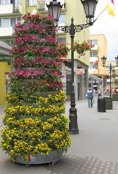 how to put flowers into the city spaces during spring? terra flower towers