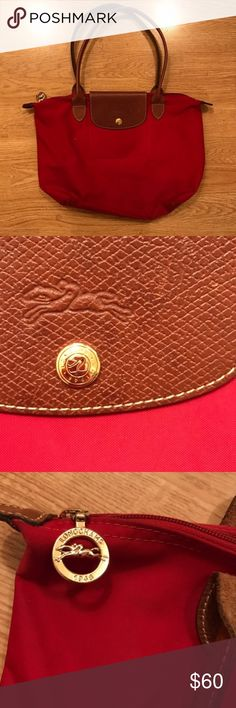 Longchamp Le Pliage Beautiful red longchamp. Small size. One minor flaw as seen in the last picture. Longchamp Bags Shoulder Bags