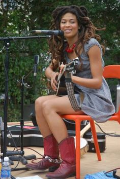 Valerie June and red boots