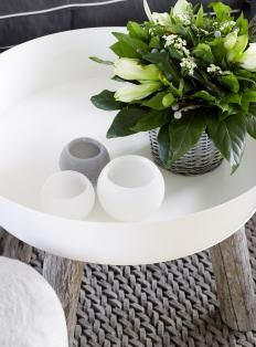 Place a small bouquet in a bowl with other related items to create a simple vignette. #floralvignette