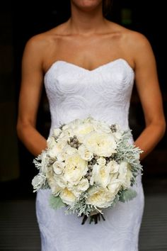 Gorgeous wedding bouquet of  garden roses, hydrangeas, and greenery.