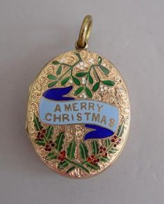 "Victorian 14k yellow gold beautifully enameled ""Merry Christmas"" sentimental locket with a banner, mistletoe and holly on the front and two palette worked hair plumes with seed pearls under glass inside, circa 1890"