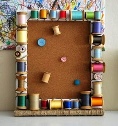 I absolutely love this take on a decorative bulletin board - made with spools of thread - colorful and creative.
