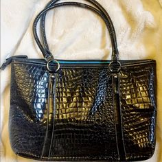 Faux Snakeskin Purse Super cute and stylish. I bought this for a play I was in, but it ended up not being right for the character. It will be someone's great fashion find! Vinyl interior. Aldo for discovery only! ALDO Bags