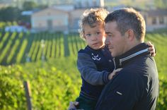 A beautiful picture: Father and son look out over vineyards in Umbria.