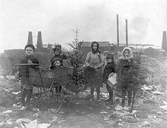 This photo taken in 1915 shows children in the city garbage dumps at 47th Street and Damen Avenue in the Back of the Yards neighborhood. Mary McDowell successfully closed them and improved living conditions for the residents.