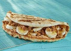 Tropical Smoothie Cafe -  Peanut Butter Banana Crunch: peanut butter, banana, granola & honey on grilled flatbread