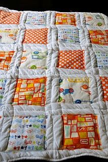Semi-homemade quilt--sew squares onto a down comforter... I like it!