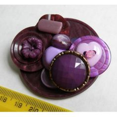 button brooch- i have some buttons that i want to use/wear so i began my search for ideas.. going to try this.
