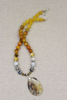 New for Fall! Free US shipping    This is my new favorite stone necklace from my fall pieces. All natural mix of yellow agate and jade