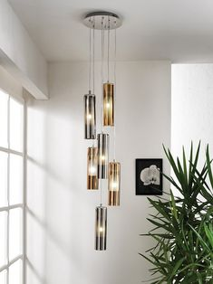 A cluster version of Cangini & Tucci's Tao Pendant. A combination cylindrical shaped pendants coated in a metalized finish hang at varying heights from a central base. Turning on the light reveals a frosted glass shape within each pendant, providing a due Entry Way Lighting Fixtures, Dining Lighting, Glass Pendant Light, Glass Pendants, Pendant Lighting, Tao, Venetian Glass, Lamp Bases, Frosted Glass