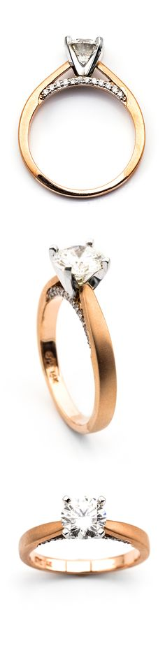 A gorgeous rose gold engagement ring that features a sparkling Diamond with a row of accent Diamonds on the side. SKU 100-00322 #engagementring #diamond #rosegold