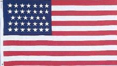 """Civil War (34 Stars) Flag Rayon On Staff 4 in. x 6 in. . $2.95. Mounted To 10"""" Staff With Spear Top. Perfect Desktop or Hand-Held Size. Our historical flags are unsurpassed in quality and authenticity. NOTE:The 4x6 size is fully printed and mounted to a 10 staff with a gold spear top.. Save 15% Off!"""