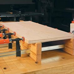 No-Fuss Panel Clamp Jig holds bar claps in place when clamping panels.