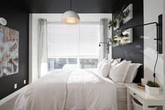 So dark it's almost black, this deep gray is a very dramatic choice. To keep your bedroom from feeling gloomy or cave-like, it helps to have at least one large window that brings in abundant sunlight. White linens also brighten the space and look crisp and clean against the dark walls. Features Five O'Clock shadow from Kelly-Moore Paints and hardware from Restoration Hardware.