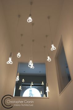 Plumen Pendants in the stairwell of a 1860's office suite redesigned by Christopher Cronin Interior Architecture
